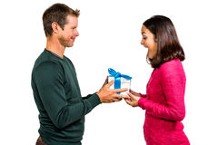 Excited girlfriend taking gift from boyfriend Royalty Free Stock Photos