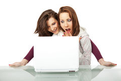 Excited girls laptop Royalty Free Stock Photography