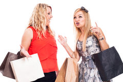 Excited girls shopping and talking Royalty Free Stock Images