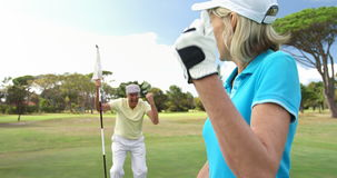 Excited golf players playing together stock footage