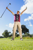 Excited golfer cheering and looking at camera Royalty Free Stock Photo