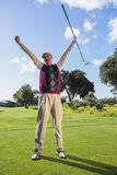 Excited golfer cheering and looking at camera Stock Photography