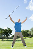 Excited golfer jumping up and smiling at camera Stock Photos
