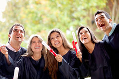 Excited graduation group Royalty Free Stock Photos