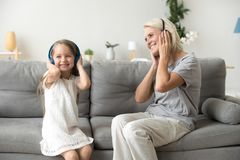 Excited grandmother and granddaughter listening to music relaxin stock image
