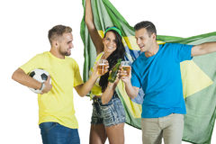 Excited group of Brazil Supporters cheers with beers and football. Excited group of Brazil Supporters holding flag and cheering with beers and football Stock Images