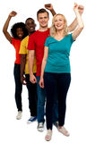 Excited group of cheerful people, full length shot Royalty Free Stock Images