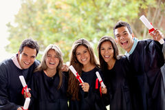 Excited group of graduates Stock Image