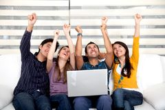 Excited group with laptop Royalty Free Stock Image