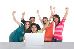 Excited group with a laptop Royalty Free Stock Images