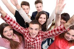 Excited group of people with arms up. Isolated over a white background Stock Image