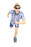 Excited guy with hat and sunglasses skating on a skate board Stock Photo