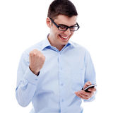 Excited guy reading good news by smartphone Royalty Free Stock Image