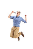 Excited guy singing on a microphone Stock Photo
