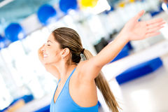Excited gym woman loosing weight Stock Image
