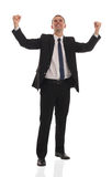 Excited handsome business man with arms raised in. Success - Isolated on white Royalty Free Stock Image