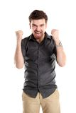 Excited handsome business man with arms raised in success Stock Photos