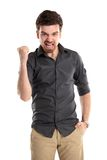Excited handsome business man with arms raised in success. Isolated on white Stock Images