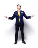 Excited handsome business man with arms raised in success Stock Photo