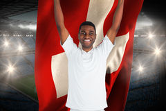 Excited handsome football fan cheering holding swiss flag Royalty Free Stock Photos