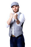 Excited handsome man with arms raised in success - Royalty Free Stock Photography