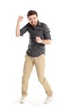 Excited handsome man with arms raised in success. Isolated on white Royalty Free Stock Photos
