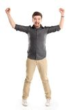Excited handsome man with arms raised in success. Isolated on white Royalty Free Stock Photo