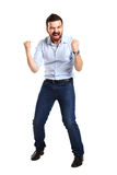Excited handsome man with arms raised in success. Isolated on white Stock Image