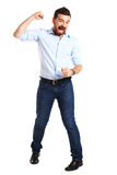 Excited handsome man with arms raised in success Stock Images