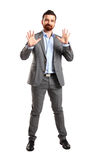Excited handsome man with arms raised in success. Isolated on white Stock Photos