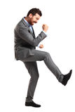 Excited handsome man with arms raised in success Royalty Free Stock Photos
