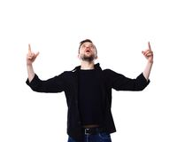 Excited handsome man with arms raised in success. Isolated on white Royalty Free Stock Photography