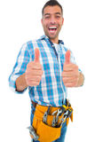 Excited handyman gesturing thumbs up Royalty Free Stock Photos