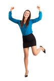 Excited happy business woman with clenched fists. Excited happy business woman with raised leg and clenched fists. Full body length isolated over white Royalty Free Stock Image