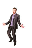 Successful excited happy businessman with raised arms. Excited happy businessman  with arms raised in success isolated on white Stock Images