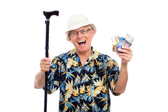 Excited happy elderly man. Holding money and walking stick, isolated on white background Royalty Free Stock Photography