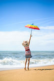 Excited happy female having fun on beach walk on sunny outdoors background Stock Photography