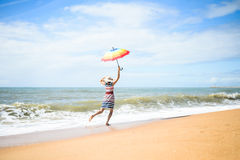 Excited happy female having fun on beach walk on sunny outdoors background Stock Photos