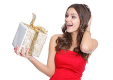 Excited happy girl with a present Stock Photos