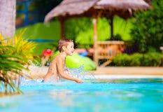 Excited happy kid boy having fun in pool, summer vacation. Excited happy kid boy having fun in hotel pool, summer vacation Stock Images