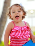 Excited happy kid girl looking Stock Photo