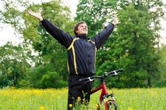 Excited happy man with hands outstretched Stock Image