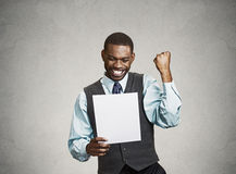 Excited happy man holding document, receiving goood news. Closeup portrait happy excited young business man executive looking monthly statement glad to pay off Stock Image