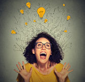 Excited happy screaming woman with many light idea bulbs above head. Closeup super excited happy screaming woman with many light idea bulbs above head celebrates stock image