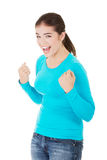 Excited happy success young woman with fists up Stock Photos