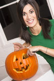 Excited Happy Woman Cutting Carving Halloween Pumpkin Lantern Stock Images