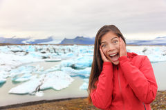 Excited happy woman at glacier lagoon on Iceland Royalty Free Stock Image