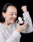 Excited, happy woman opening gift Stock Photography