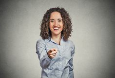 Excited happy woman smiling, laughing, pointing finger towards you Royalty Free Stock Photos