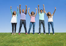 Excited and Happy Young Adults. Five young adults displaying a healthy and excited image. A multi-ethnic group is represented in this photo Royalty Free Stock Photos